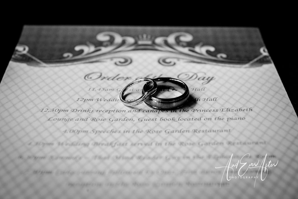 Wedding rings on the order of wedding service booklet