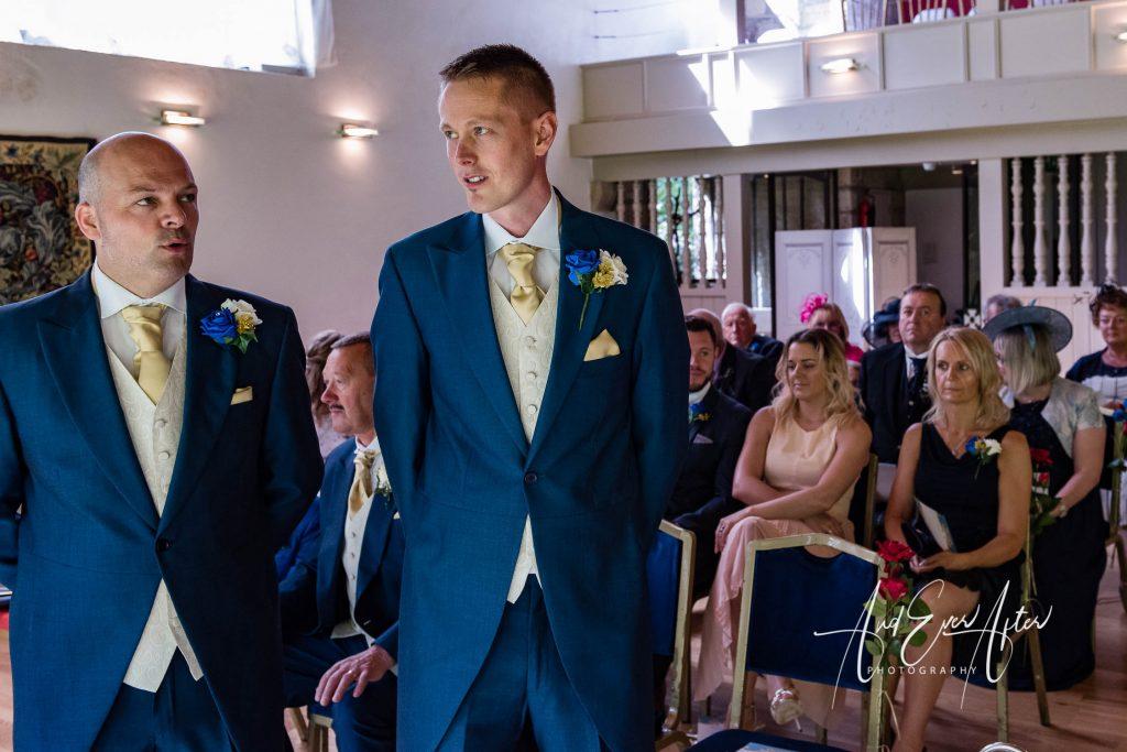 nervous looking groom before the wedding ceremony