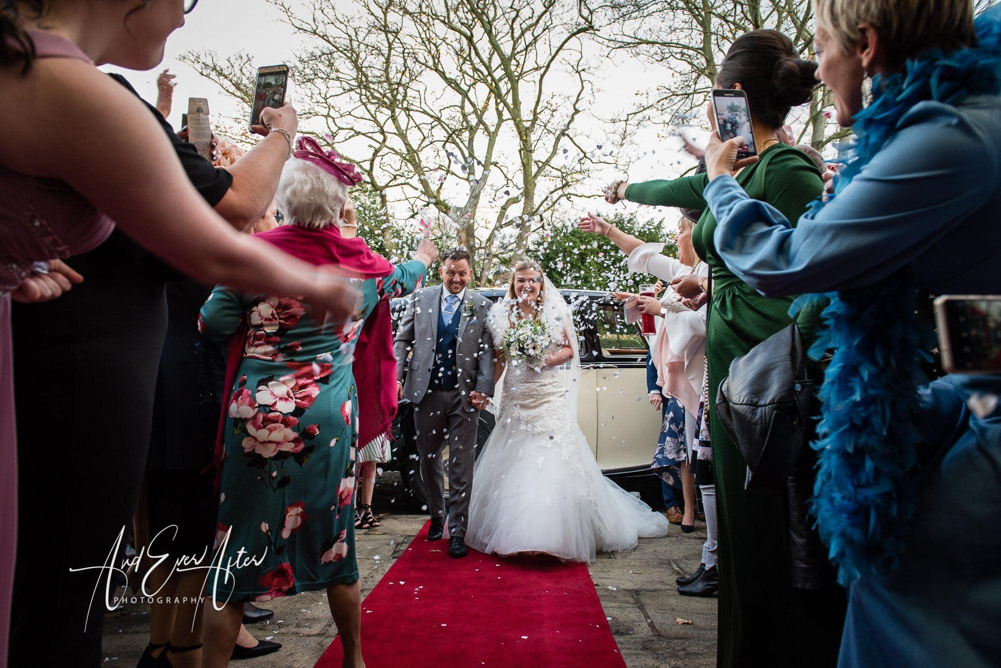 bride, groom, confetti