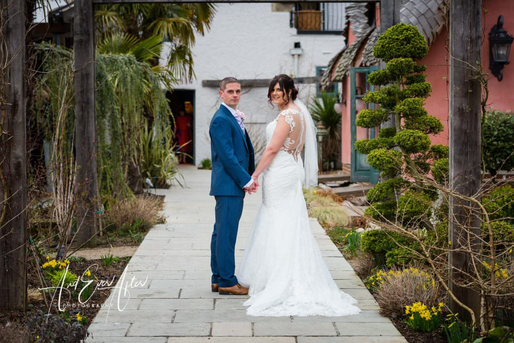 Bride and groom in their wedding photographs at Le Petit Chateau