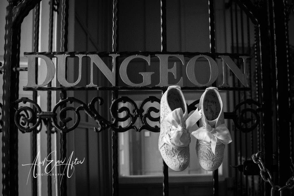 Wedding shoes at gate to dungeo, walworth castle