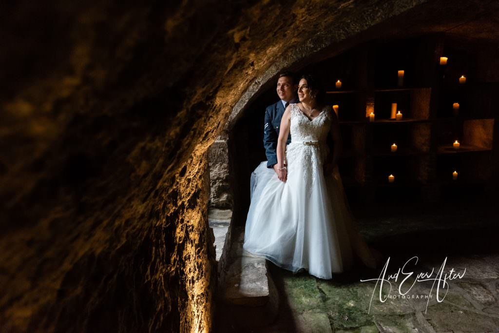 bride and groom photograph in dungeon at walworth castle