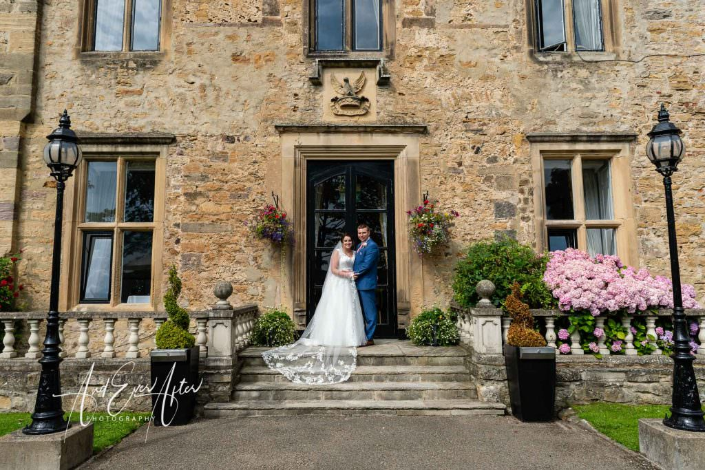 bride and groom at walworth castle, wedding day, photo at side of castle