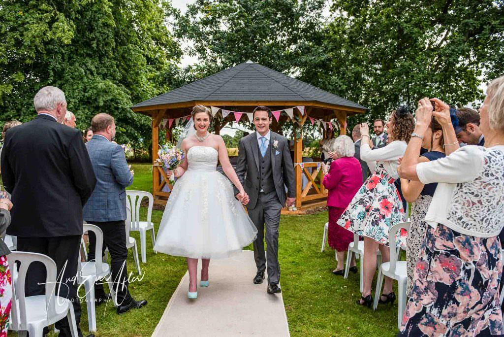 Outdoor wedding ceremony, Solberge Hall, bride and groom in garden