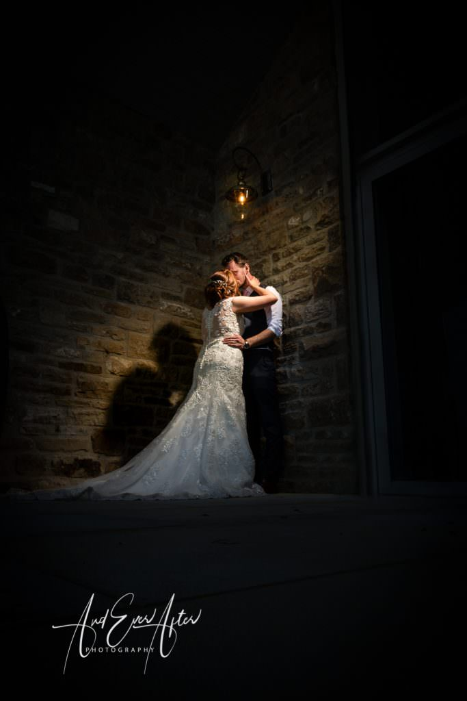 bride and groom kissing at the Yorkshire Wedding BArn