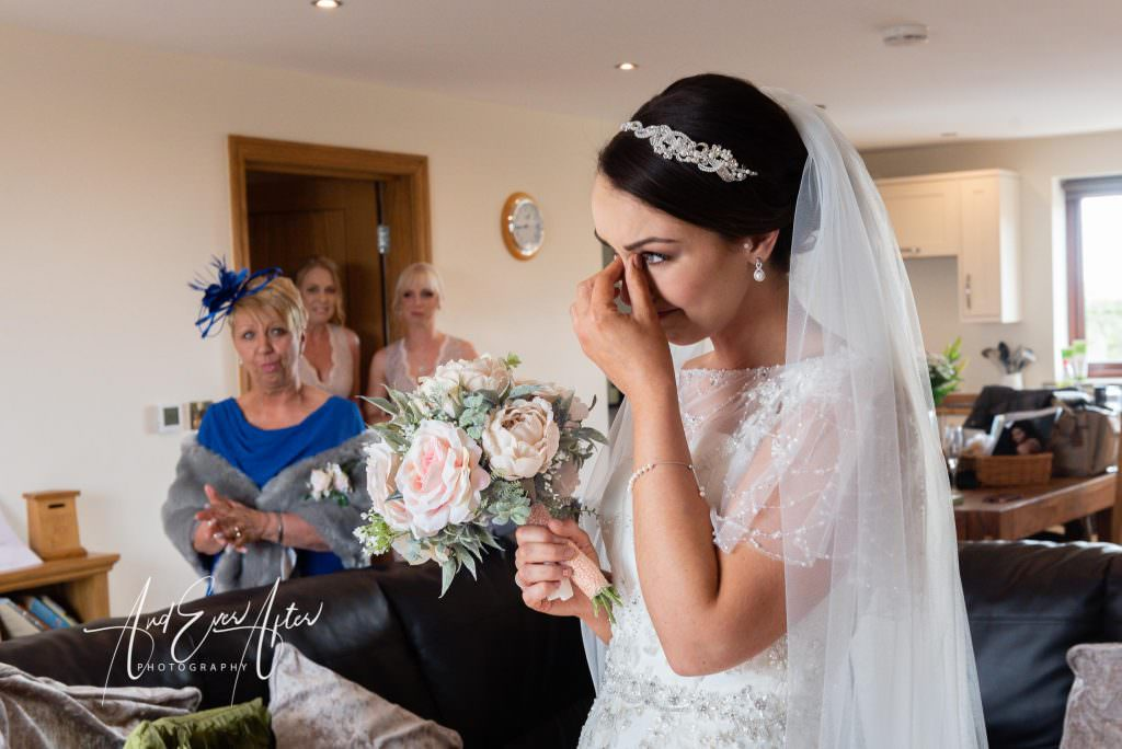 bride crying after seeing her father