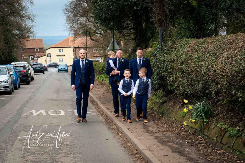 wedding party walking to church