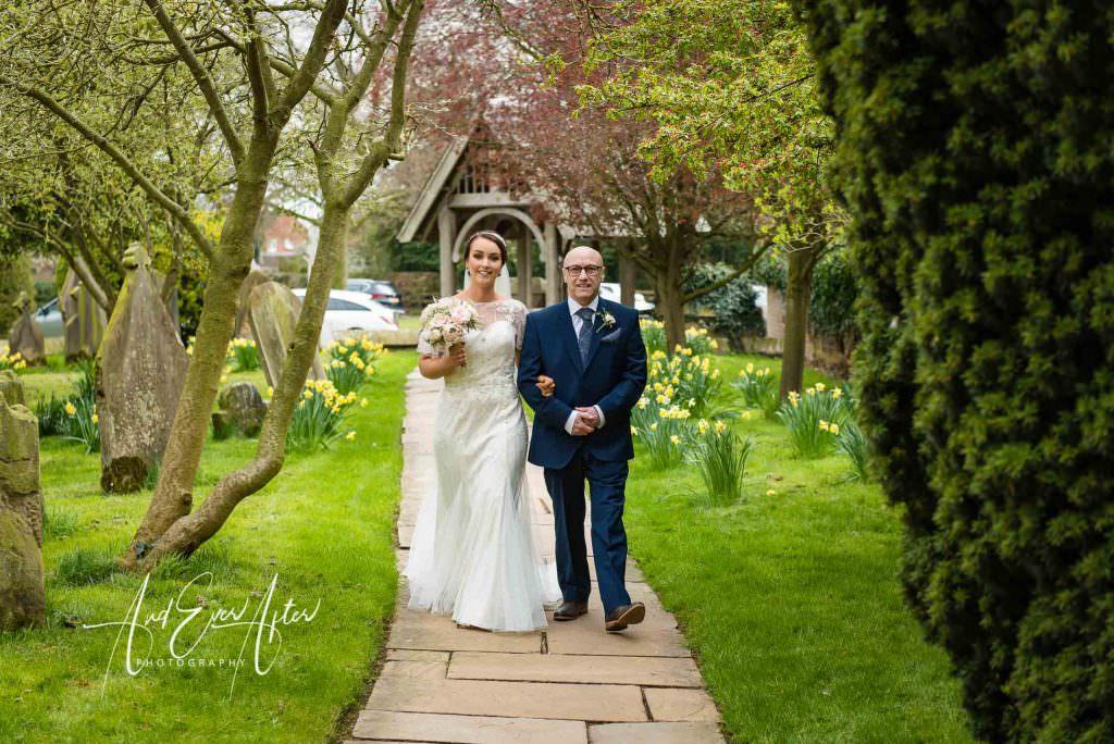 Thief hall wedding photographer bride and dad walking towards church