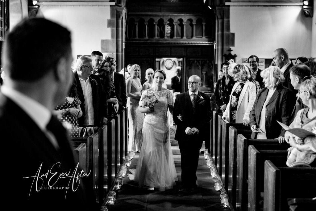 Thief hall wedding photographer walking up the aisle