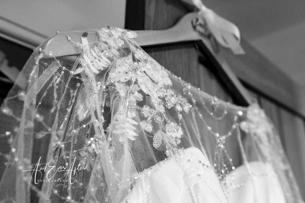 brides dress hanging up Thief hall wedding photographer