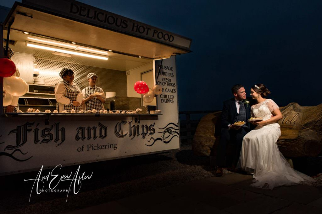 Thief hall wedding photographer bride and groom eating fish and chip supper