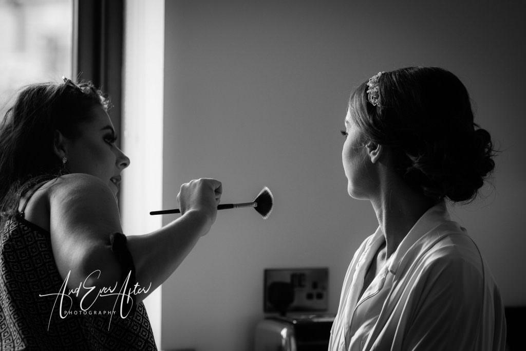Thief hall wedding photographer bride having make up applied