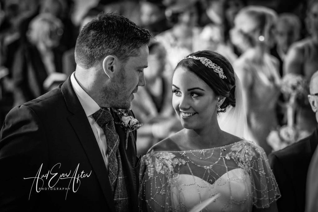 bride looking at groom in church