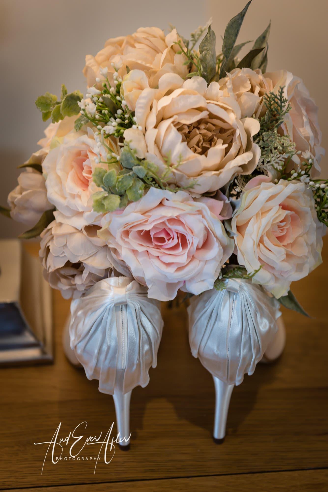 Brides shoes, wedding flowers