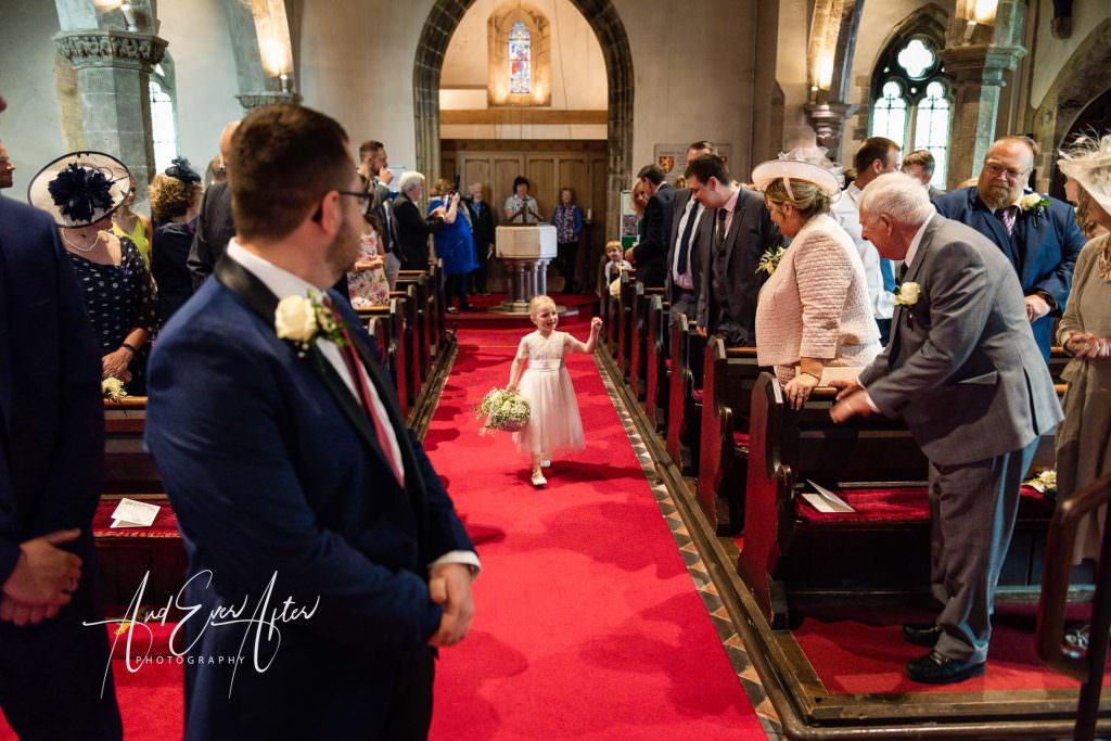 wedding photography at Goldsborough Hall, the bride has arrived at the church for er wedding