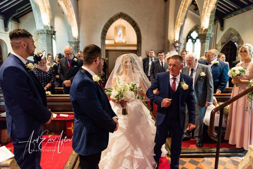 wedding photography at Goldsborough Hall, the bride has arrived at the church for her wedding