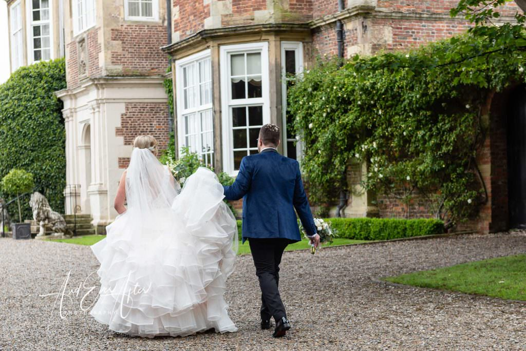 wedding photography at Goldsborough Hall, bride and groom celebrating their wedding day after being married