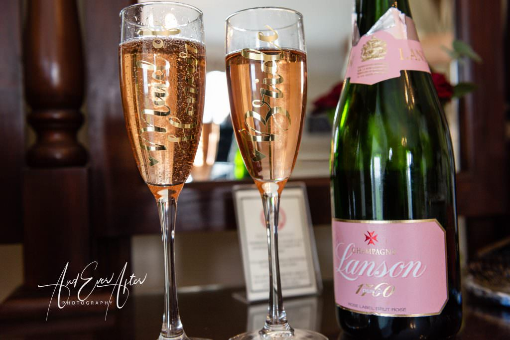 wedding day bridal preparations at Goldsborough Hall, campagne and two glasses
