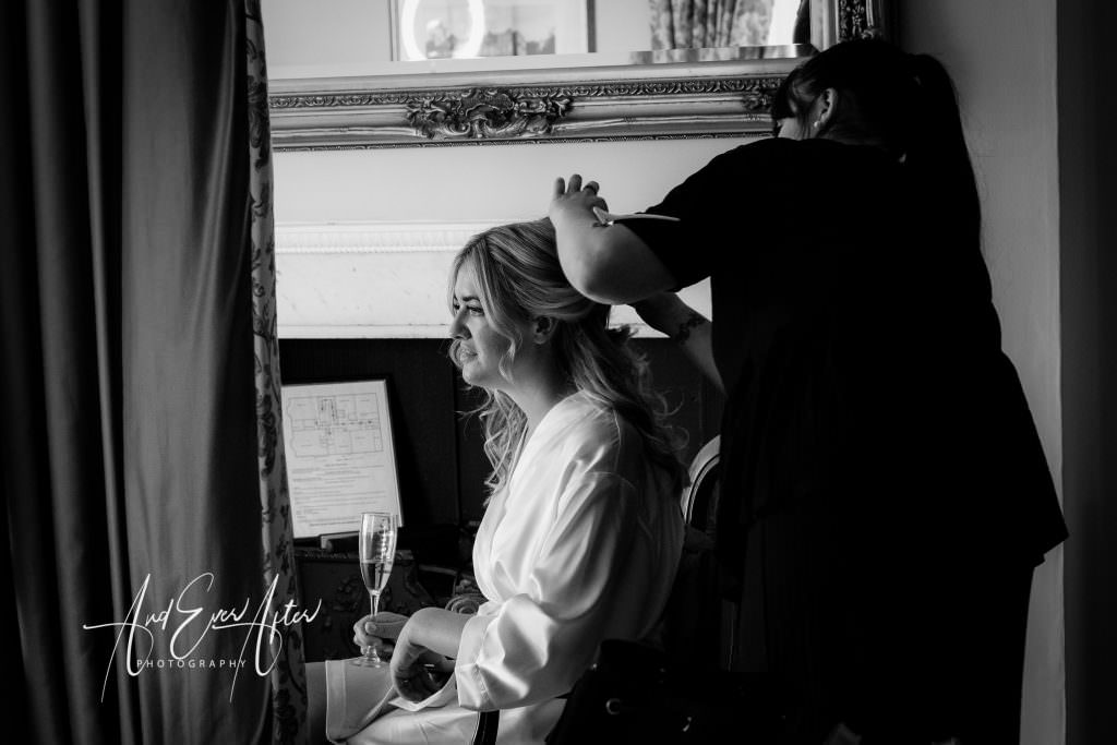 wedding day bridal preparations at Goldsborough Hall - bride having her hair made up
