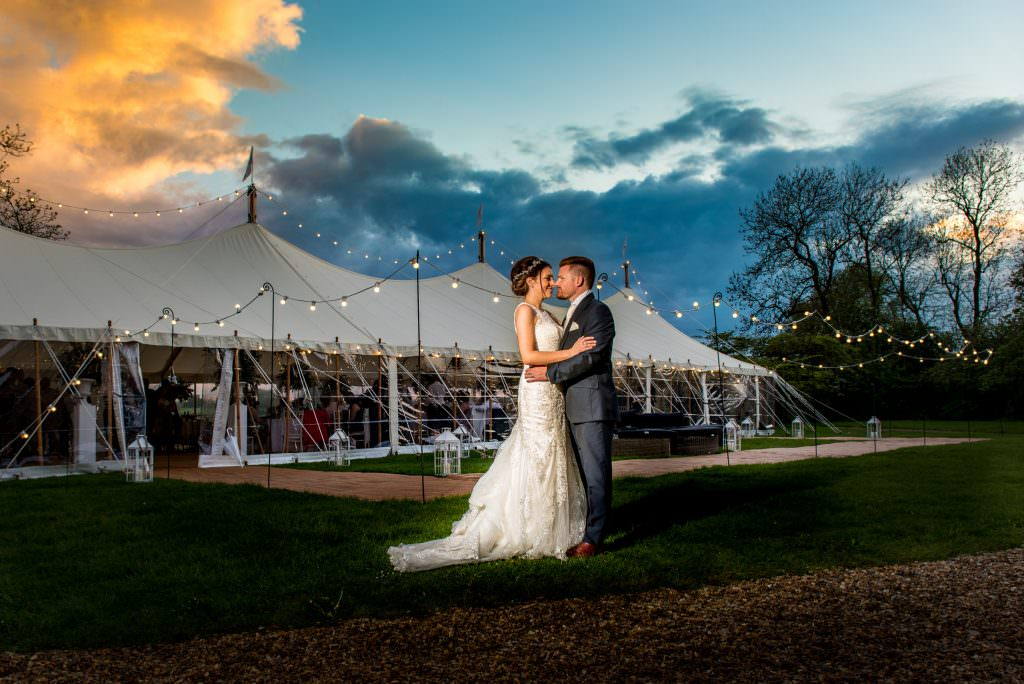 bride and groom at their wedding celebrations, marquee wedding, choosing your wedding photographer