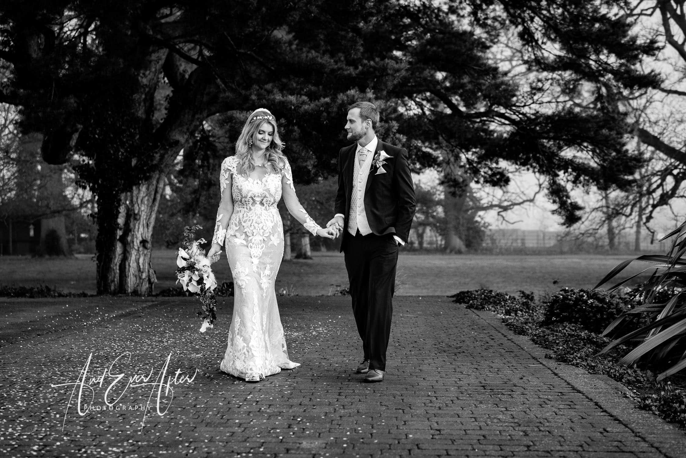 rockliffe hall wedding, county durham wedding photographer, bride and groom walking in the grounds of Rockliffe Hall, wedding day