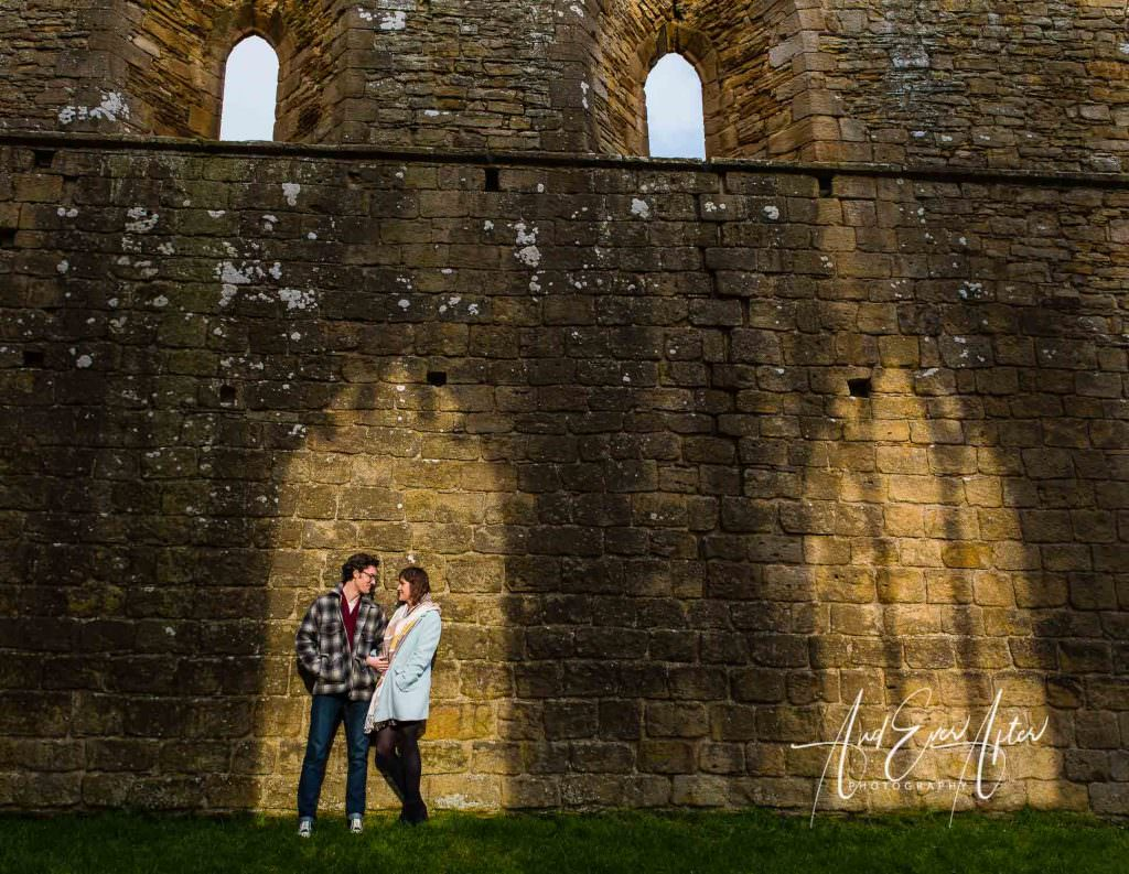 engagement photshoot, bride and groom to be at abbey ruins on photoshoot