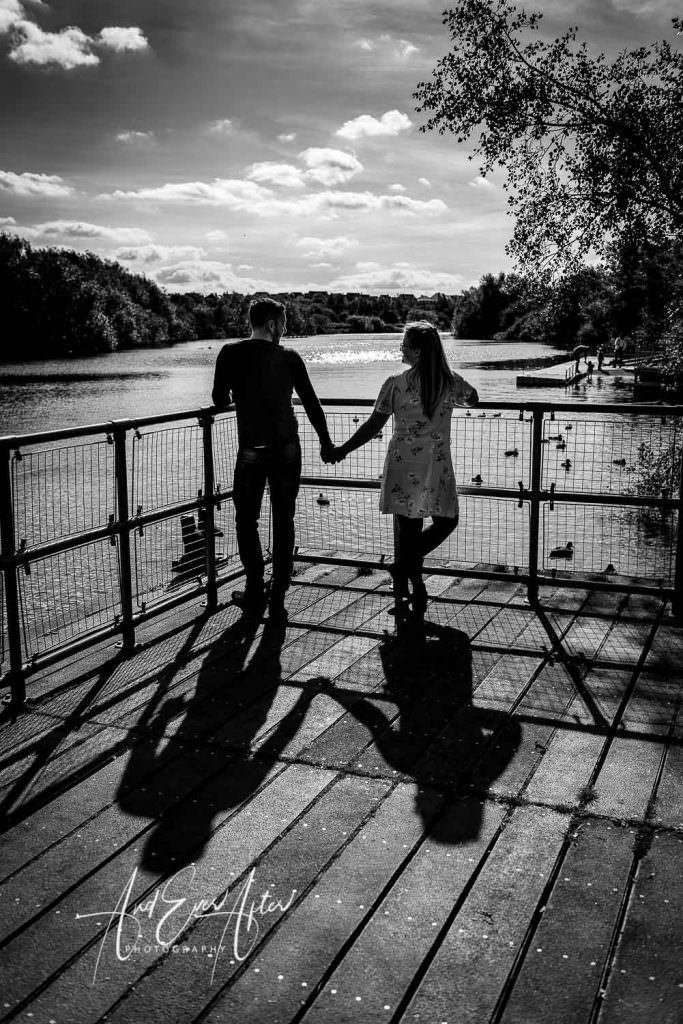 engagement photo session with a bride and groom to be holding hands looking at each otehr