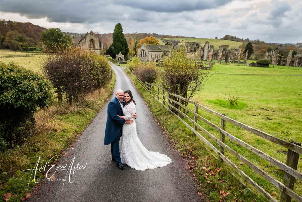 bride and groom photographed at Easby Abbey In North Yorkshire