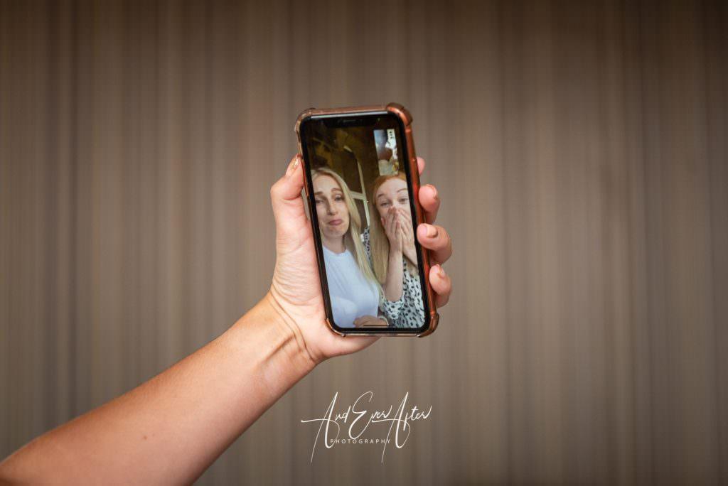 bride video messaging her friends