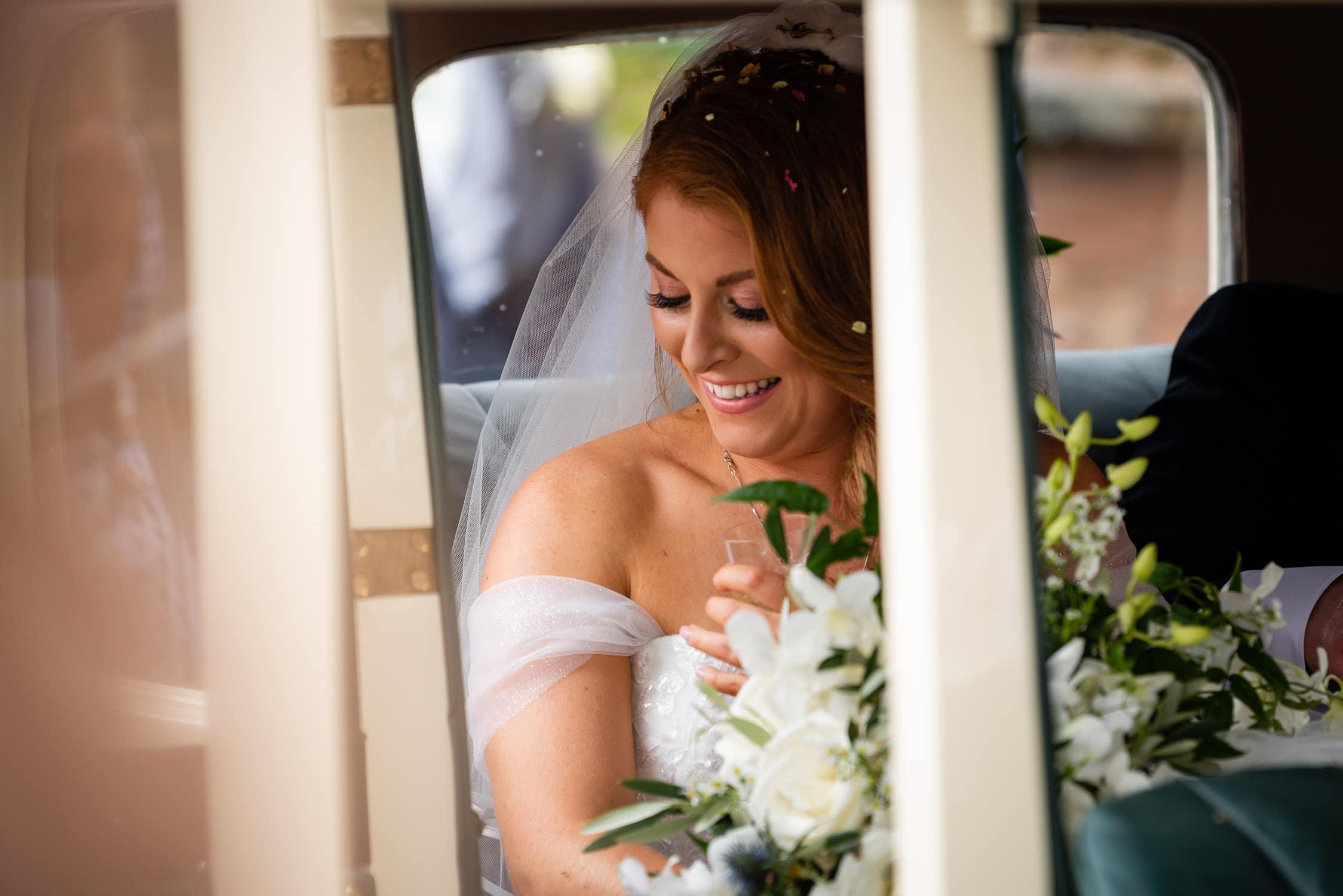 bride in her wedding car